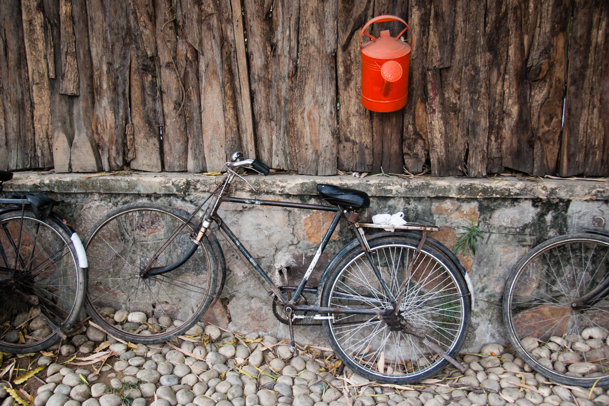 Red Watering Can and Bikes