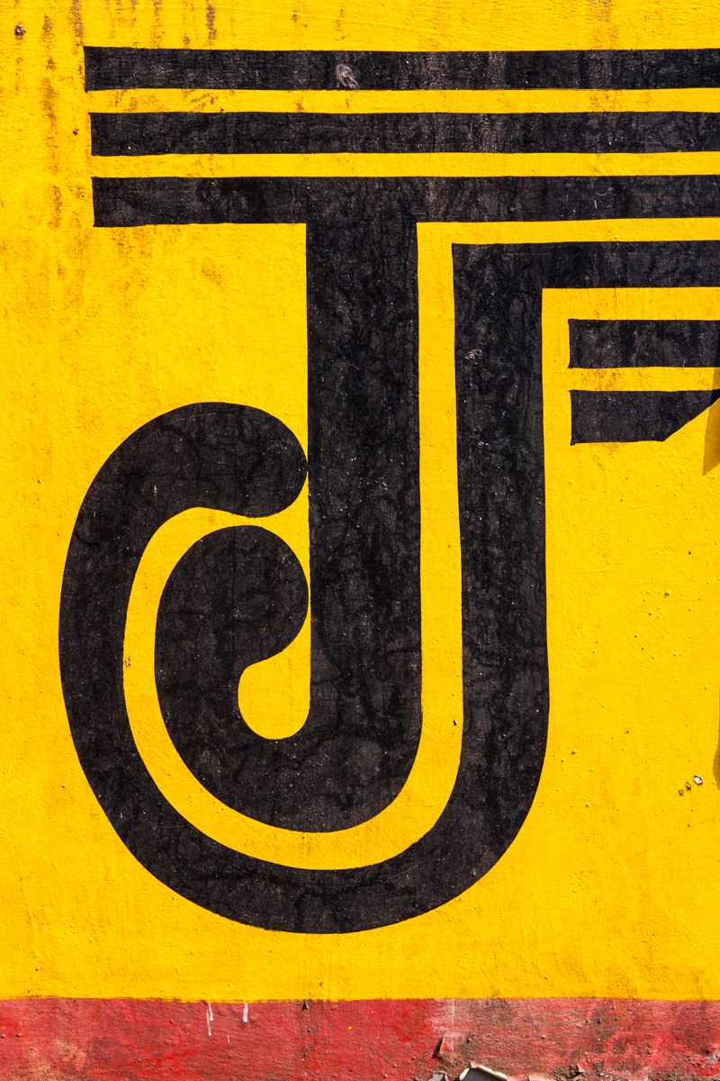 Black J on Yellow