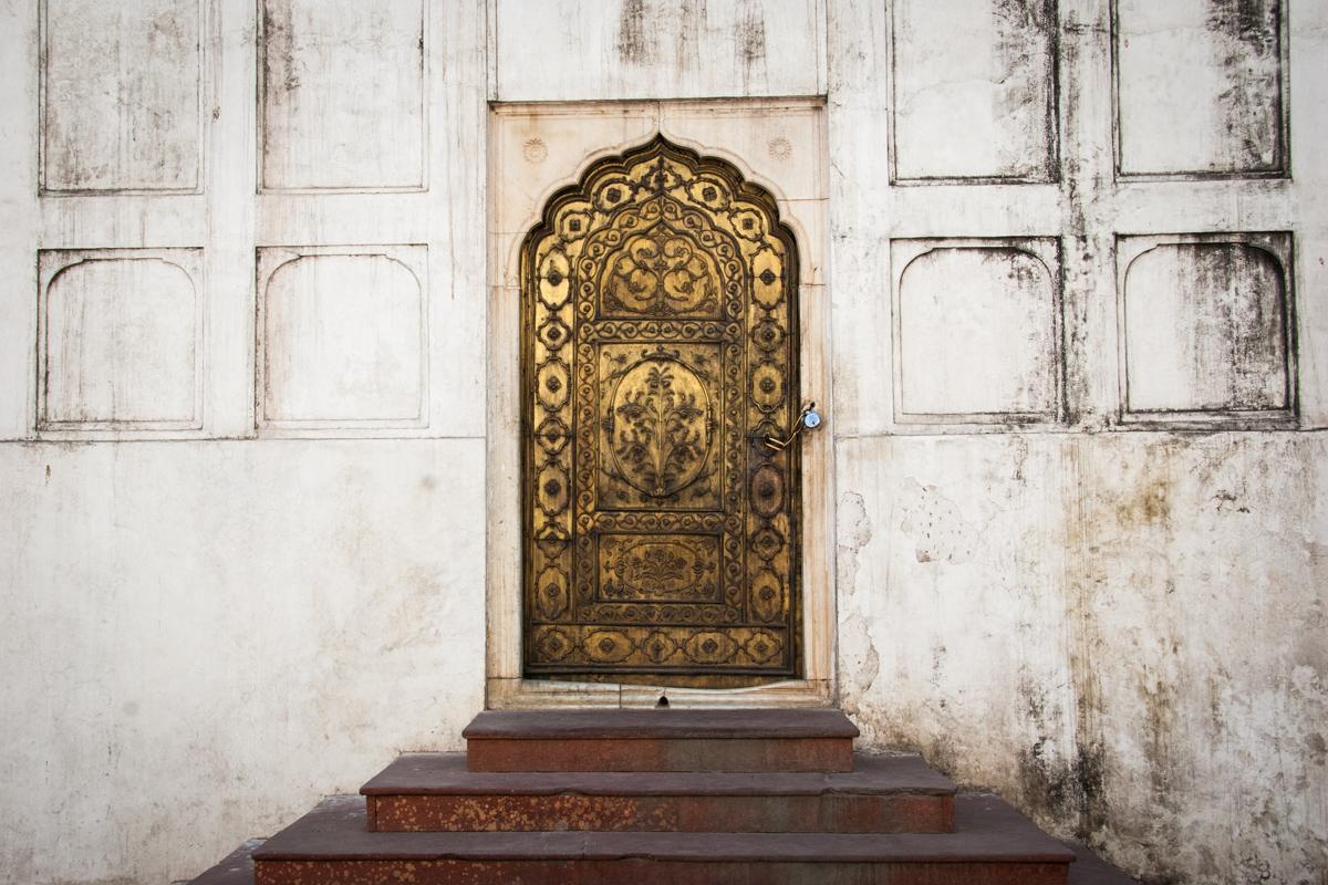 Bronze Door in White Wall