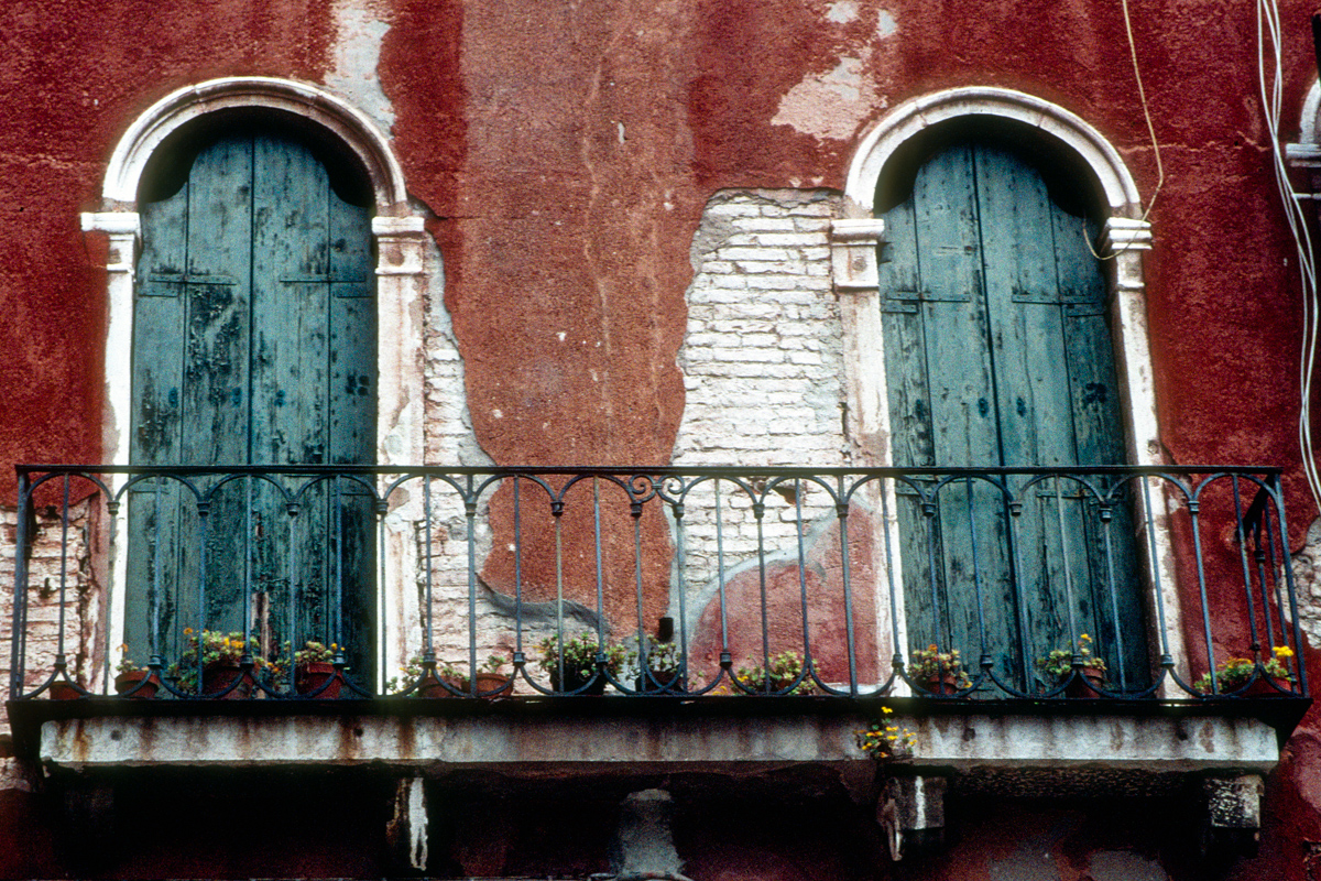 Dual Windows on Red Wall