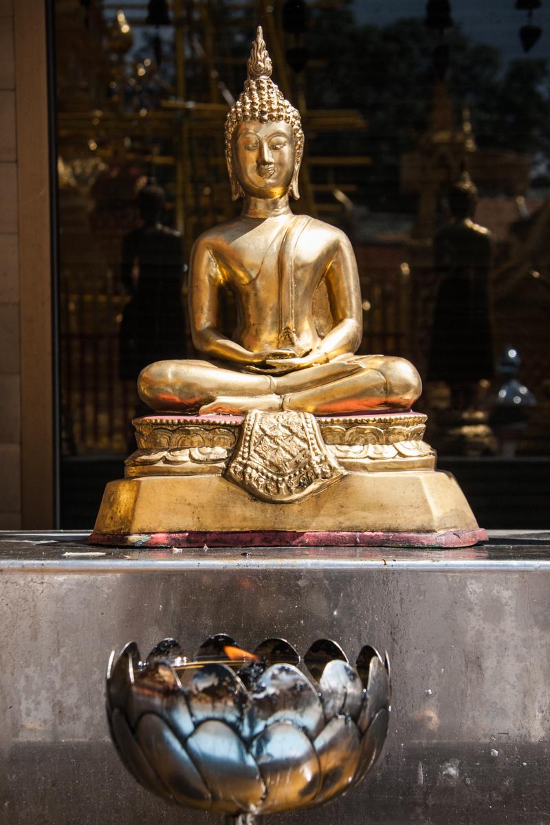 Seated Buddha and Lotus Lamp