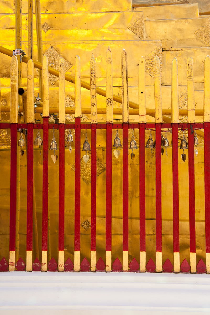 Red and Gold Fence With Bells