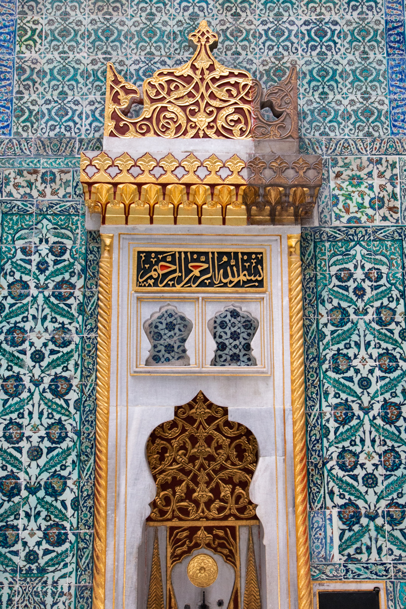 Gilded Wall Decoration Against Tile