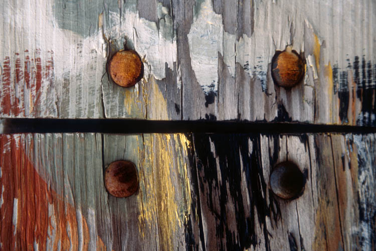 Painted Fence with Rusty Bolts